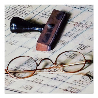 Ledger With Eyeglasses and Rubber Stamp Poster