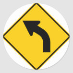 Left Curve Ahead Highway Sign Classic Round Sticker