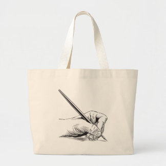 Left hand holding pen large tote bag
