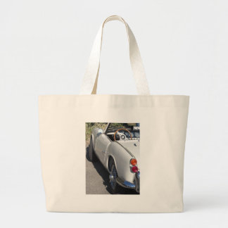 Left side of an old british classic car large tote bag