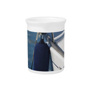 Left side of sailing boat with two blue fenders beverage pitcher