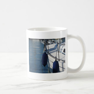 Left side of sailing boat with two blue fenders coffee mug