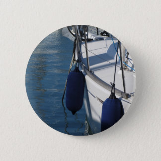 Left side of sailing boat with two blue fenders pinback button