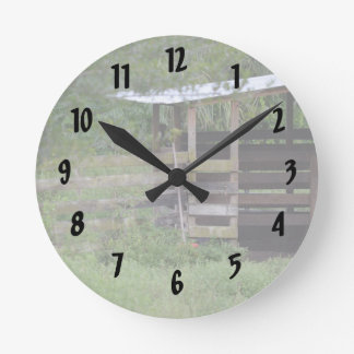 left side of wooden horse barn stall round clock