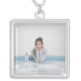 Legs apart silver plated necklace