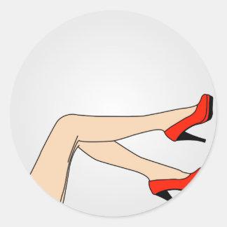 Legs of a woman wearing red stilettos classic round sticker