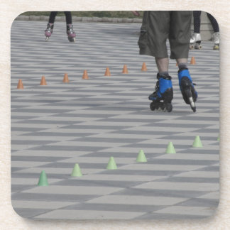 Legs of guy on inline skates . Inline skaters Coaster