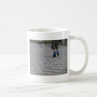 Legs of guy on inline skates . Inline skaters Coffee Mug