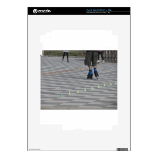 Legs of guy on inline skates . Inline skaters Skins For iPad 2