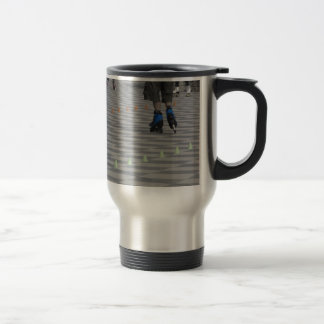 Legs of guy on inline skates . Inline skaters Travel Mug