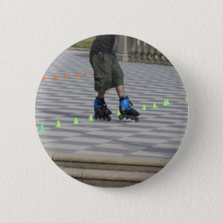 Legs of guy on rollerblades. Rollerblader Button