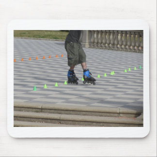 Legs of guy on rollerblades. Rollerblader Mouse Pad