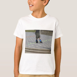 Legs of guy on rollerblades. Rollerblader T-Shirt