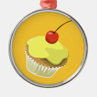 Lemon cupcake with cherry ornament