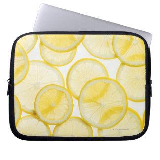 Lemon slices arranged in pattern backlit laptop sleeves