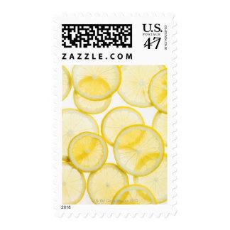 Lemon slices arranged in pattern backlit postage
