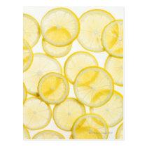 Lemon slices arranged in pattern backlit postcard