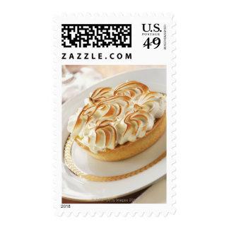 Lemon tart with baked meringue on plate postage