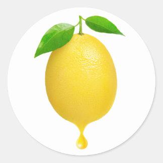 Lemon with drop of juice classic round sticker