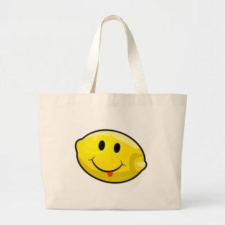 Lengua amarilla sonriente del limón bolsa tela grande