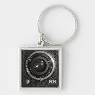Lente de cámara del vintage en un llavero