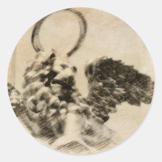 León con alas pegatina redonda