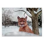 León de montaña en nieve felicitación