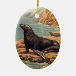 León marino del mamífero marino del vintage por la adorno ovalado de cerámica