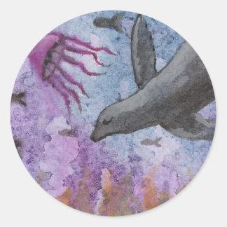 León marino y pulpo etiquetas redondas