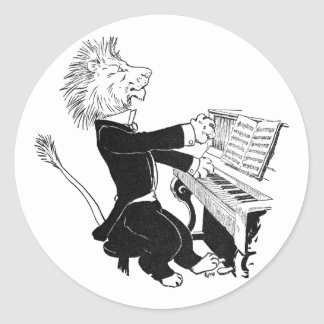 León que juega el dibujo antiguo de Louis Wain del Pegatina Redonda