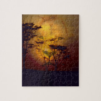 León que mira sobre puesta del sol africana puzzle