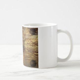 león rugiente taza de café