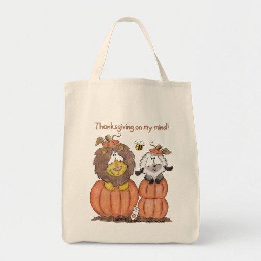 León y cordero en calabazas bolsas