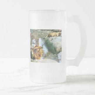 Leones y reflexiones taza de café