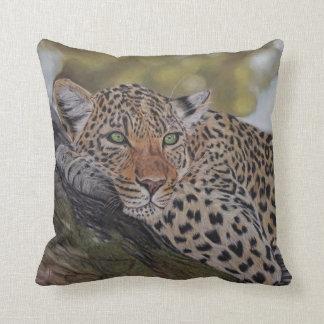 Leopard cat lying in a tree pillow