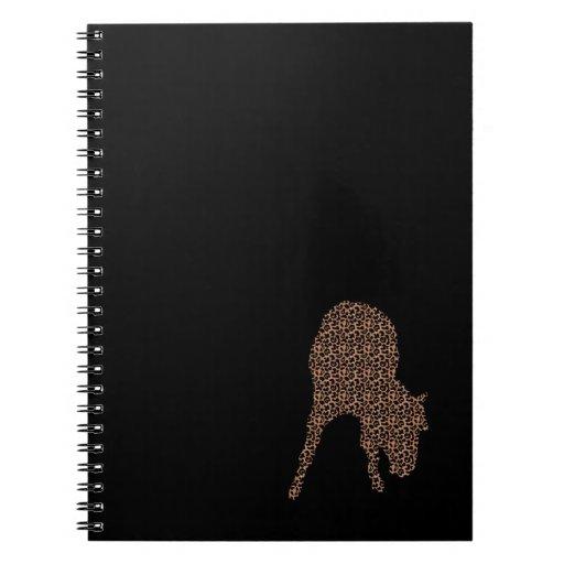 Leopardo del caballo en el cuaderno negro de la si