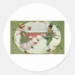 Leprechauns in love classic round sticker