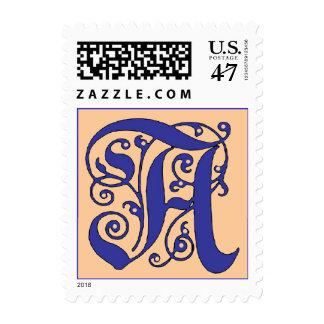 Letra adornada del monograma un sello azul