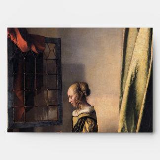 Letra de la lectura del chica en la ventana abiert