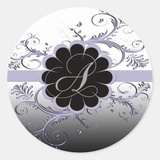 Letra del monograma una violeta etiquetas redondas