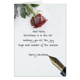 Letra del navidad de la sobrina en el papel subió  tarjeta de felicitación