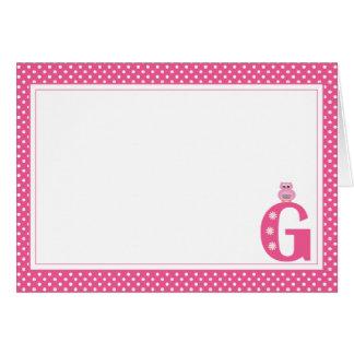 Letra G con la tarjeta de nota del espacio en blan