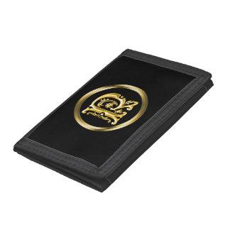 Letra inicial de R en oro