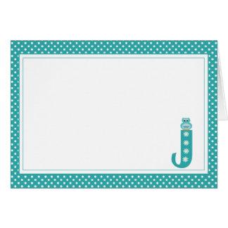 Letra J con la tarjeta de nota del espacio en blan