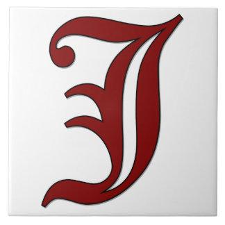 Letra J de Cantorbery en teja roja del monograma