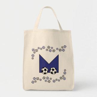 Letra M en tote azul del monograma del fútbol Bolsas Lienzo