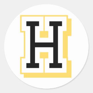 Letra negra y amarilla H Pegatina Redonda