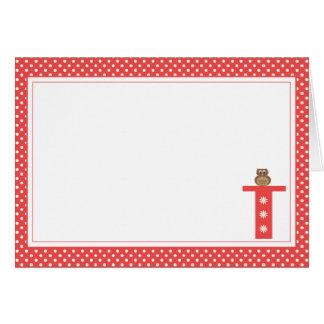 Letra T con la tarjeta de nota del espacio en blan
