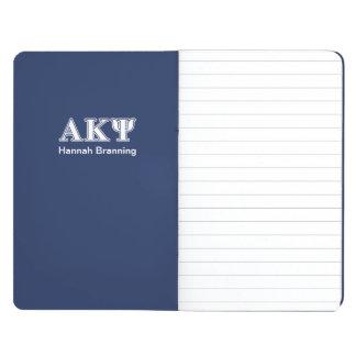 Letras alfa del blanco y de la marina de guerra de cuadernos grapados