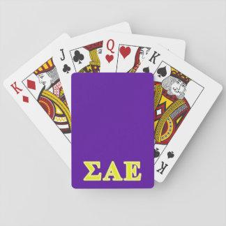 Letras amarillas épsilones alfa de la sigma baraja de póquer